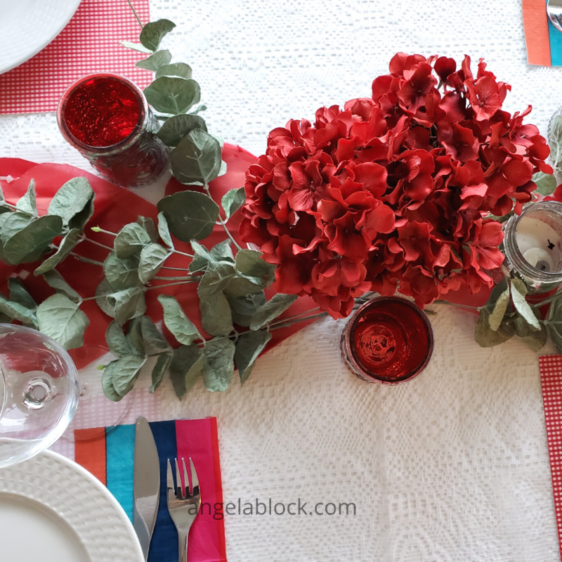 Valentine's Day flowers and candles as table décor