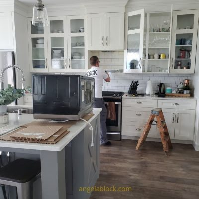 Taking down the old microwave in our Kitchen Update. How we updated our kitchen-2021 kitchen design updates
